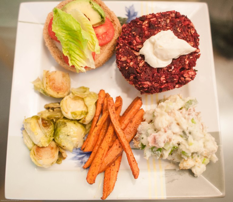beet burgers, carrot fries, roasted brussel sprouts and potato salad