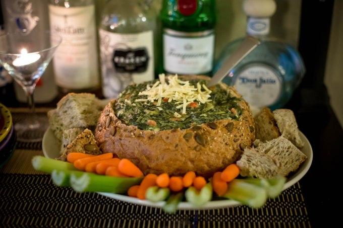 spinach artichoke dip in prairie bread bowl